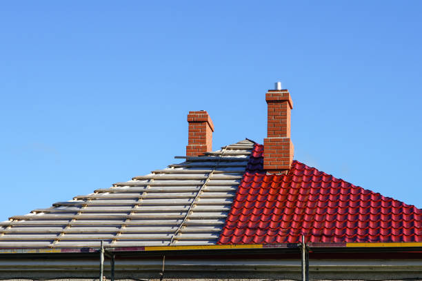 roof replacement of a residential house, half replaced, half not yet replacement of the roofing of a residential house on a background of blue sky, half changed, half not yet replacement stock pictures, royalty-free photos & images