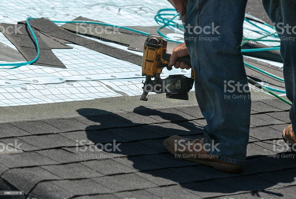 Roof shingle replacement stock photo