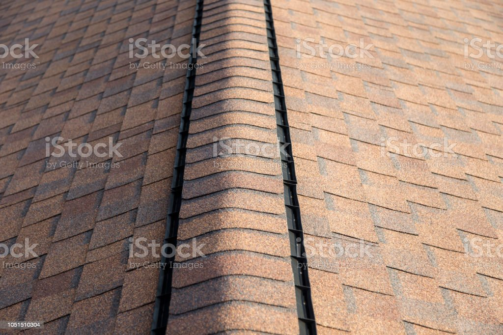 Roof Shingles with Ridge Vent stock photo