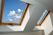 skylight windows, blue sky with puffy white clouds
