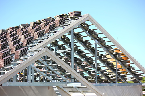 group of roof tile prepare on roof steel structure for worker