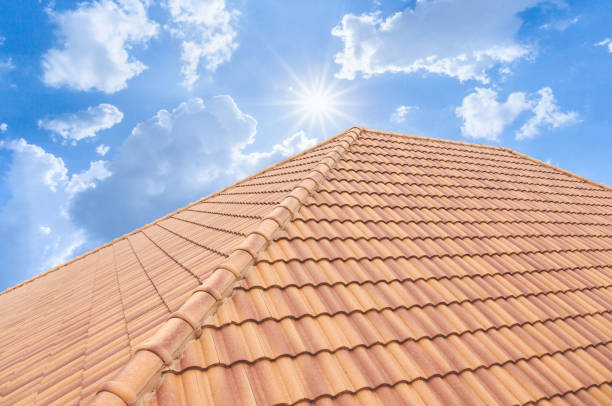 Roof tiles and sky sunlight. Roof tiles and sky sunlight. Roofing Contractors concept Installing House roof. replacement stock pictures, royalty-free photos & images