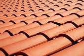 Terracotta colored roof tiles close-up