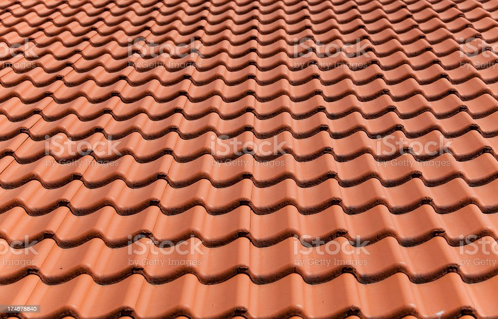 Roof tiles neatly arranged over each and looking like waves royalty-free stock photo