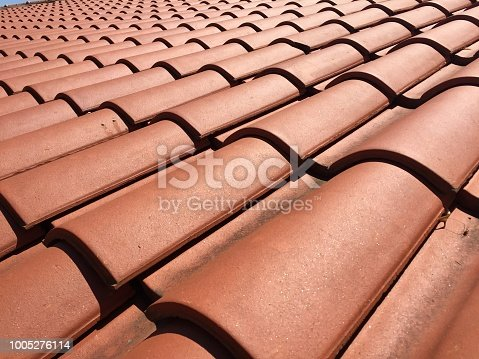 Close-up of roof tiles on bright sun