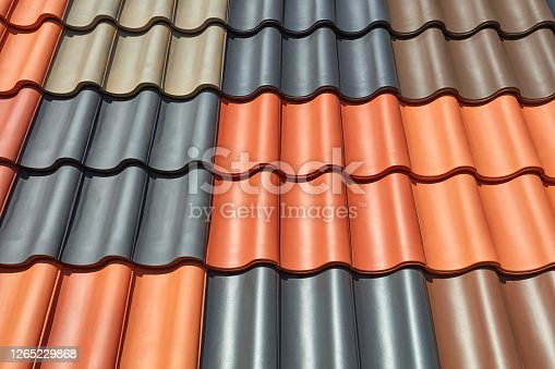 A roof is covered with different colored roof tiles.