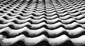 Roof tiles of a bungalow covered with snow.
