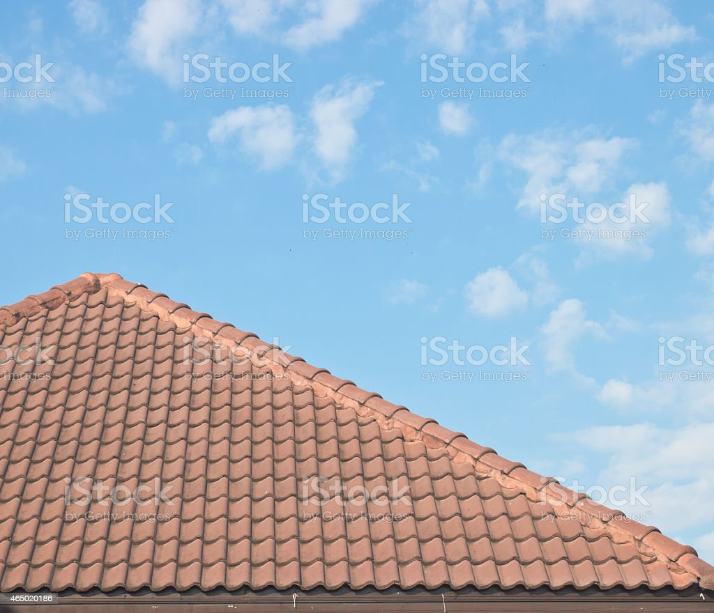 Roof tiles under blue sky stock photo