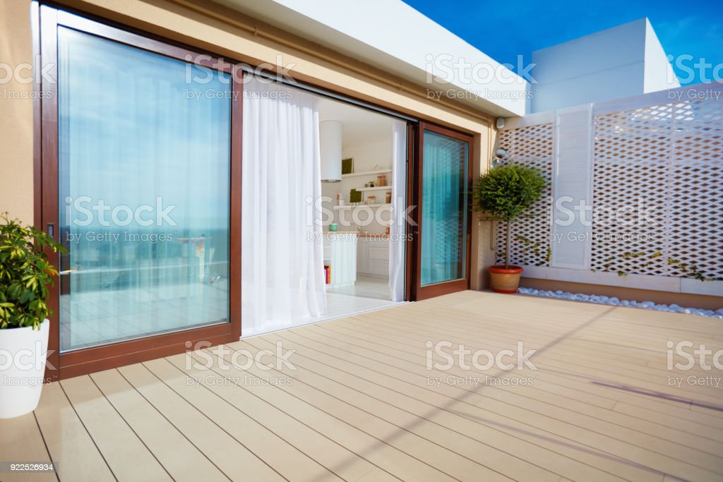 Roof Top Patio With Open Space Kitchen Sliding Doors And Decking On