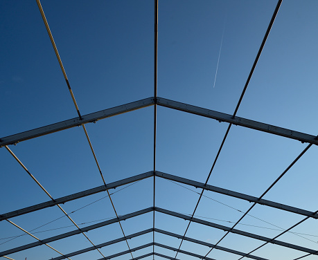 Ocean City, Maryland i preparing for another fall tourist event and the tents are being erected on the oceanfront, here is the roof structure with a great blue sky background