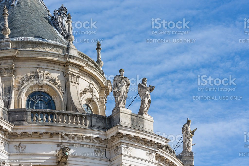 Roof with ornaments and statues Palace Versailles near Paris, France stock photo