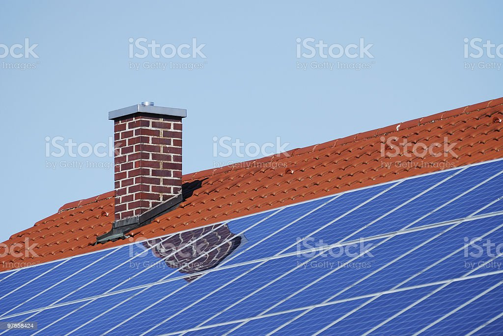 Roof with photovoltaic cells royalty-free stock photo