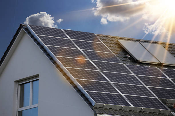 roof with solar panels (photovoltaics) - solar panel imagens e fotografias de stock