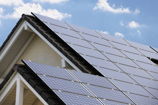 Roof with solar panels (photovoltaics) stock photo