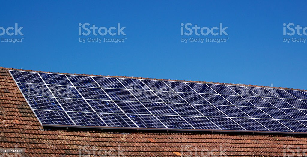 Roof with solar panels royalty-free stock photo