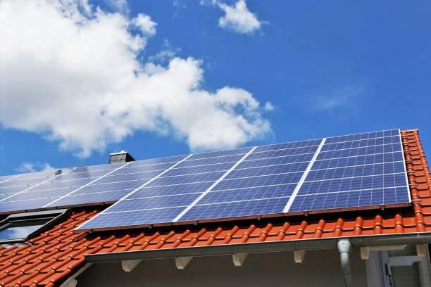 roof with solar panels - pannelli solari foto e immagini stock