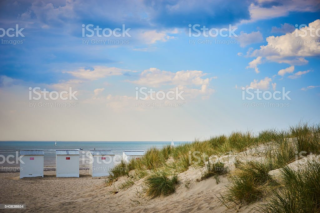 Roofed beach chairs at beach of Nieuwpoort in Belgium stock photo