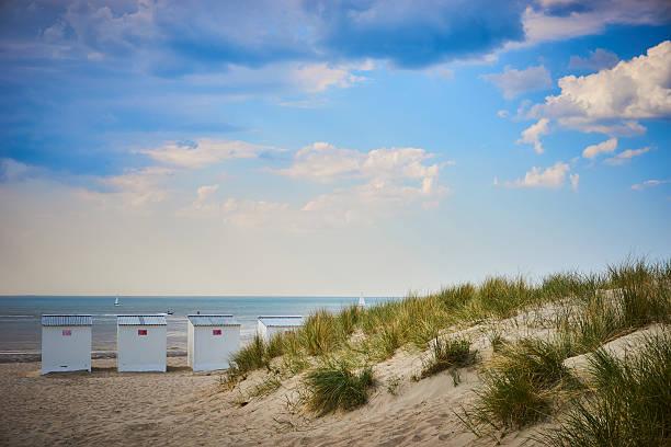 Roofed beach chairs at beach of Nieuwpoort in Belgium - foto de stock