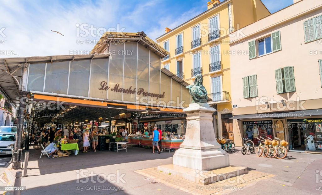 roofed market hall with unidentified tourists in Antibes stock photo