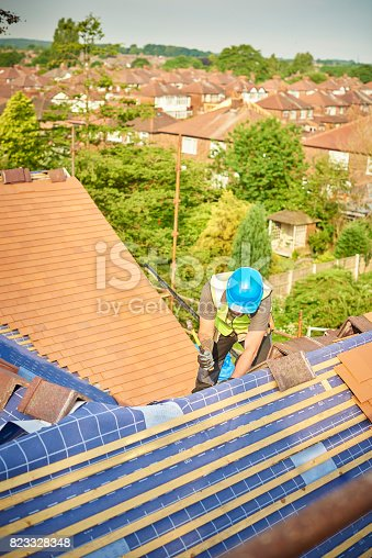 istock roofer at work 823328348
