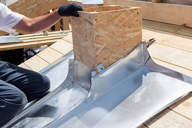 roofer builder worker attach metal sheet to the chimney - blech biegen stock-fotos und bilder