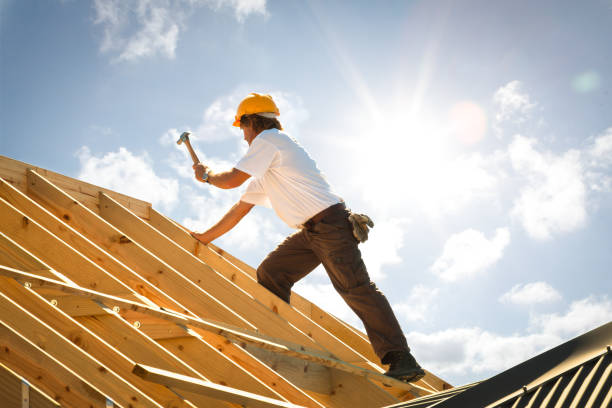 roofer carpenter working on roof stock photo