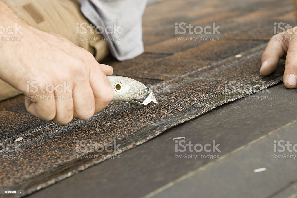 Roofer Cutting New House Shingle royalty-free stock photo