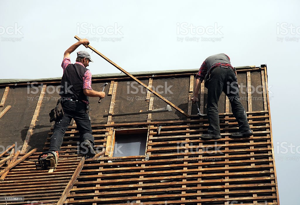 roofer in action royalty-free stock photo