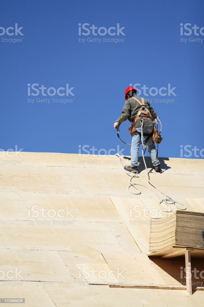 Roofer In Safety Harness stock photo