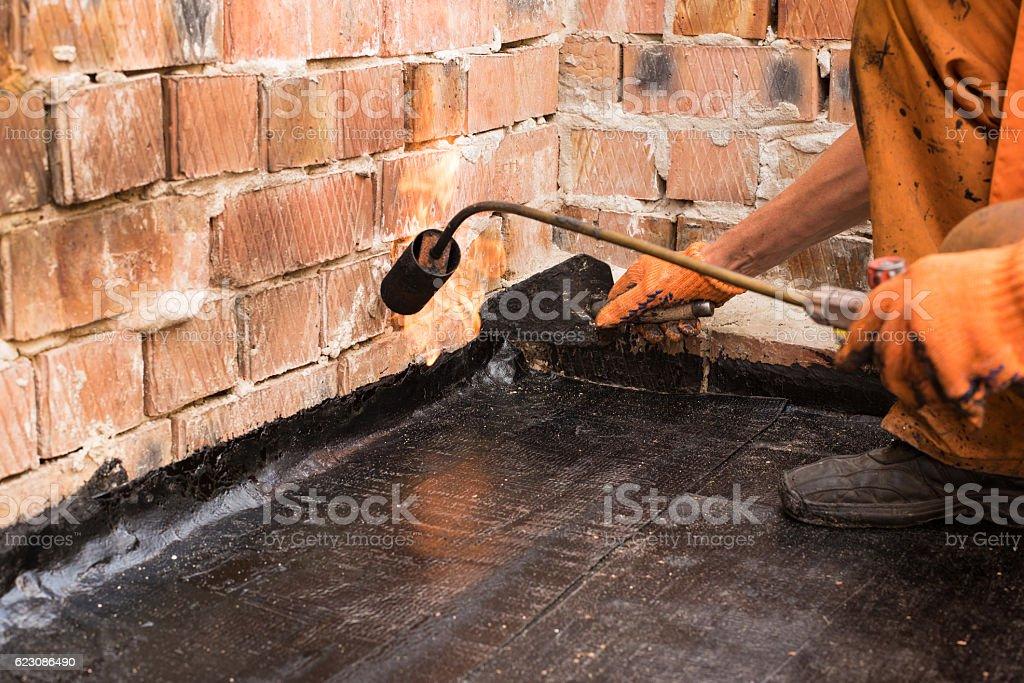 Roofer make repair stock photo