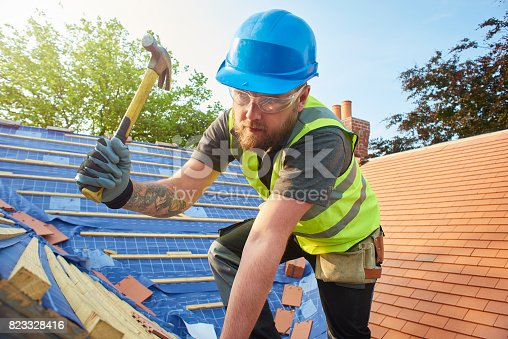 istock roofer nailing battens 823328416