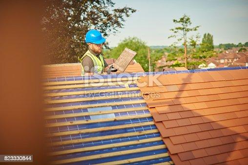 istock roofer on the ridge 823330844