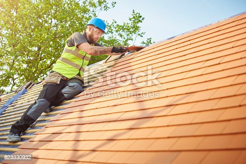 istock roofer on the roof 823330932