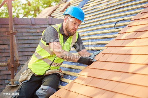 istock roofer on the roof 823331008