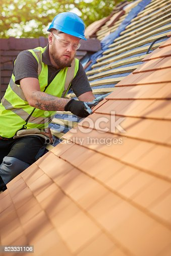 823328086istockphoto roofer on the roof 823331106