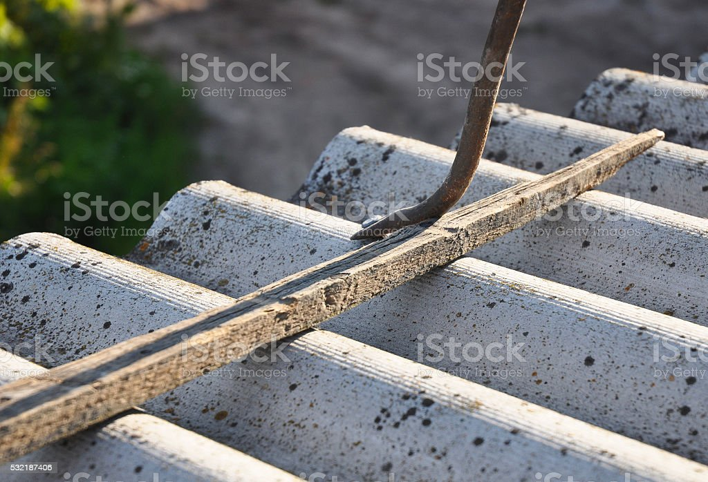 Roofer repair dangerous asbestos old roof tiles. Roofing construction. stock photo