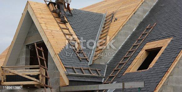 Roofer  Roof in slate tiles  Modern House