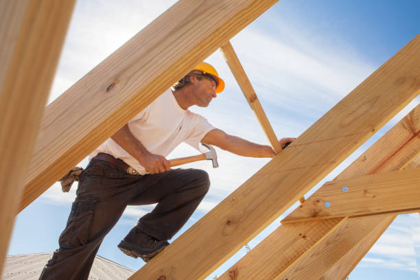 roofer worker builder working on roof structure at construction site stock photo