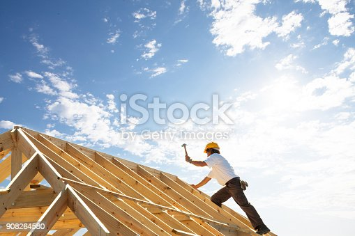 professional roofer in his working environment with tools of the trade