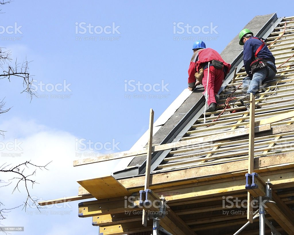 roofers are working on the roof royalty-free stock photo