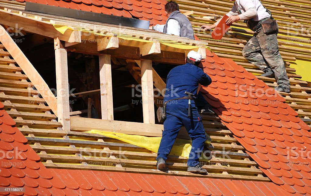 roofers at work royalty-free stock photo