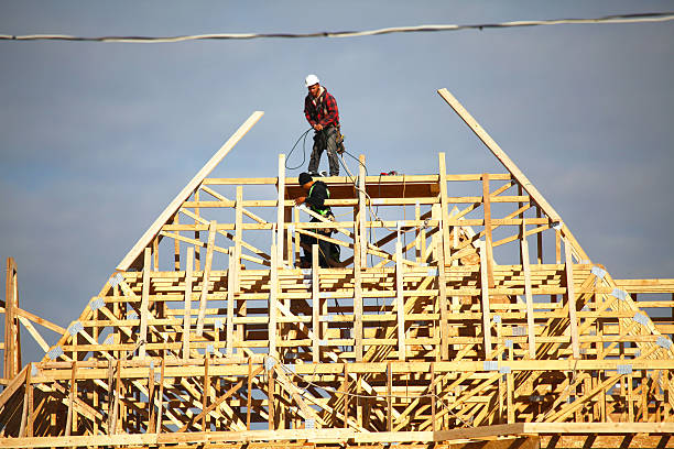 roofers building a new roof frame for a new house - fall prevention stock photos and pictures