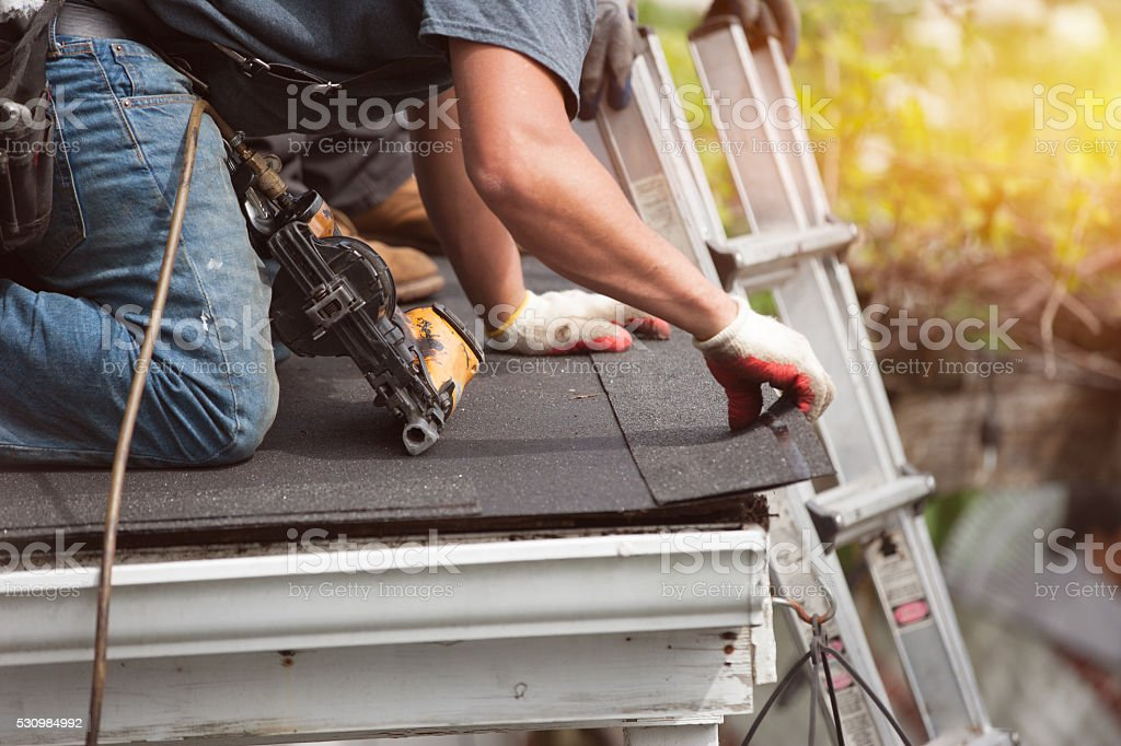 roofers installing new roof on house royalty-free stock photo