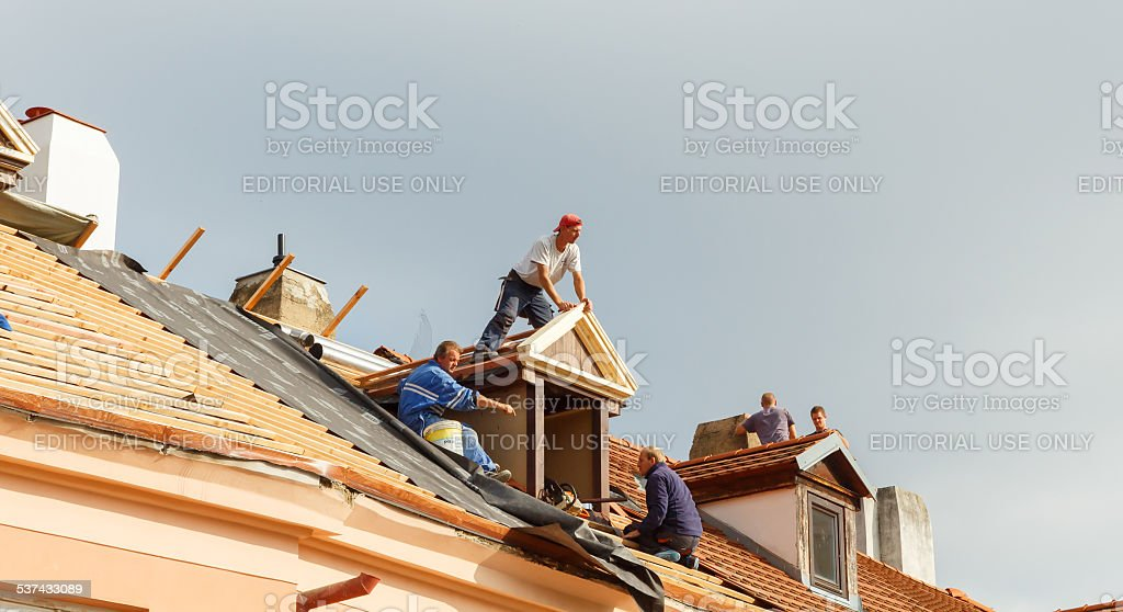Roofers on the roof. stock photo