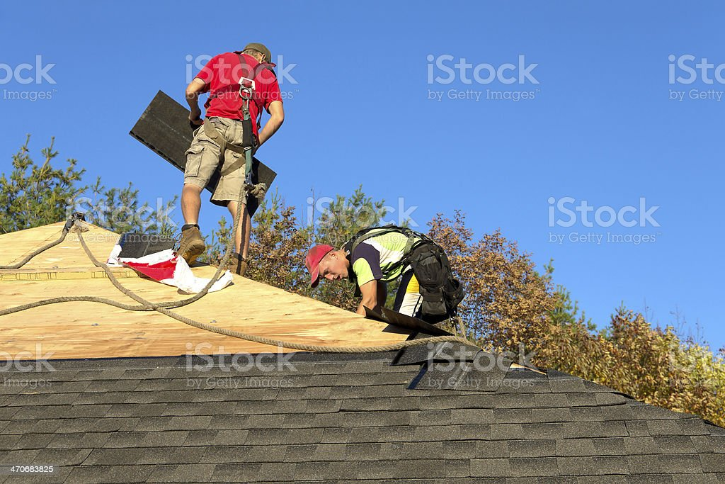 Roofers with Safety Equipment stock photo