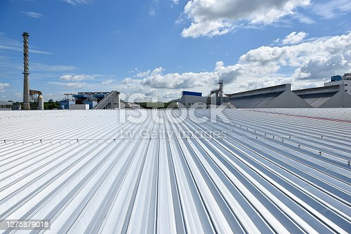 Roofing and lightning faraday systemon installed on new warehouse with exsiting old building warehouse and blue sky background