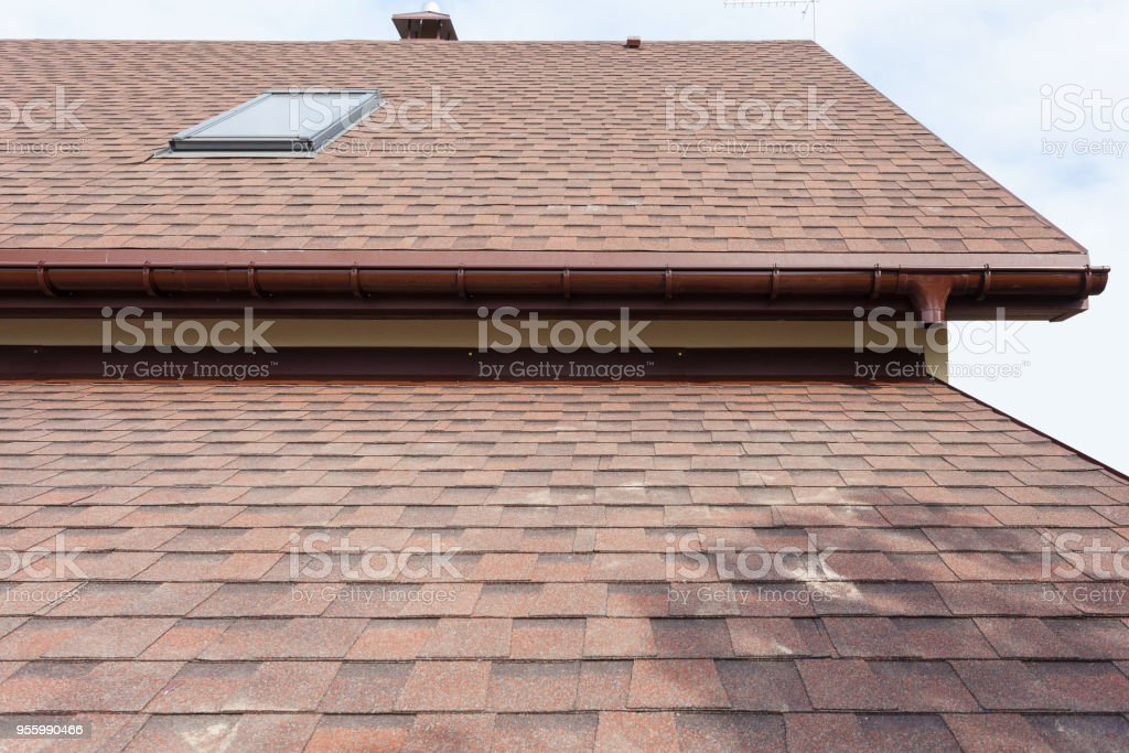 Roofing construction and building new house with modular chimney,  dormers and eaves stock photo