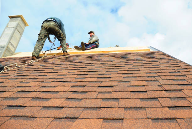 Roofing contractors install new house roofing with asphalt shingles. Roofer working on a home with safety rope. Roofing contractor. stock photo