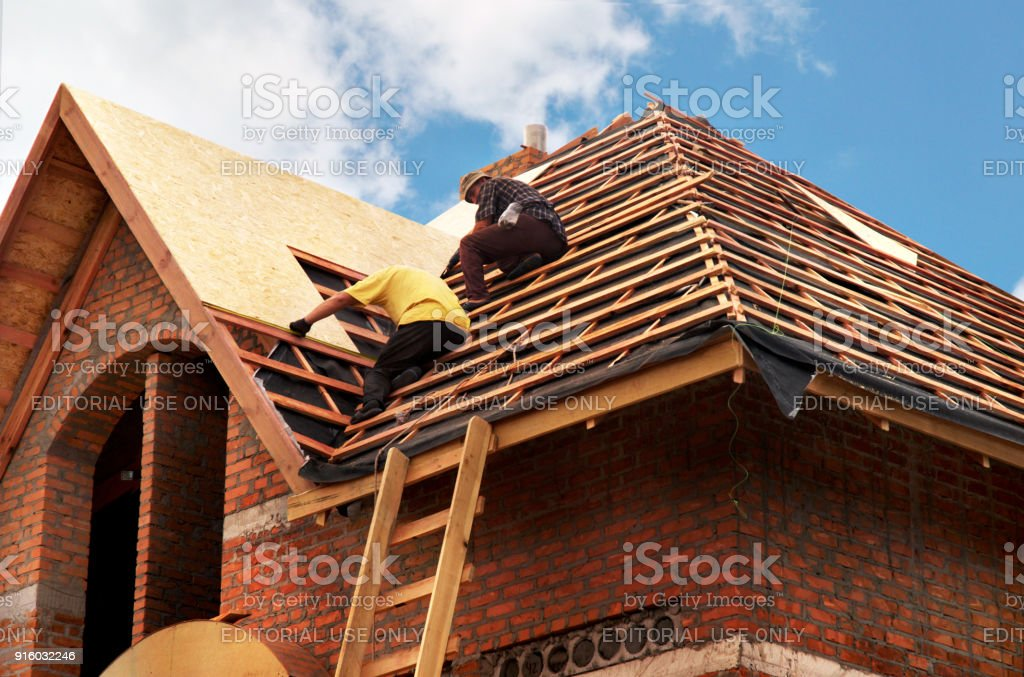 Roofing Contractors Installing House Roof Board for Asphalt Shingles. Roofing Contractor. Roofing Construction. Roof Repair. stock photo