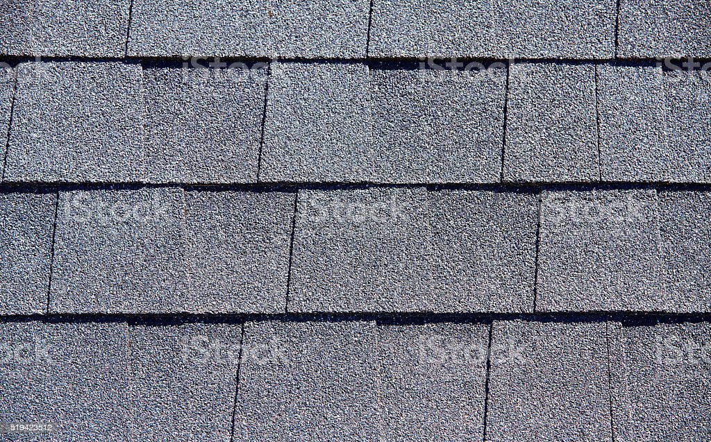Roofing Shingles dark gray tab style pattern stock photo
